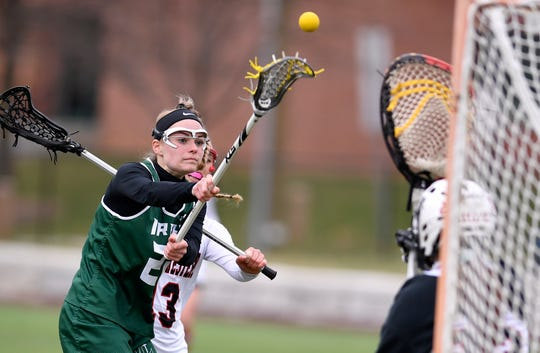 York Catholic's Natalie Neiman shoots and scores against South Western, Tuesday, April 2, 2019.