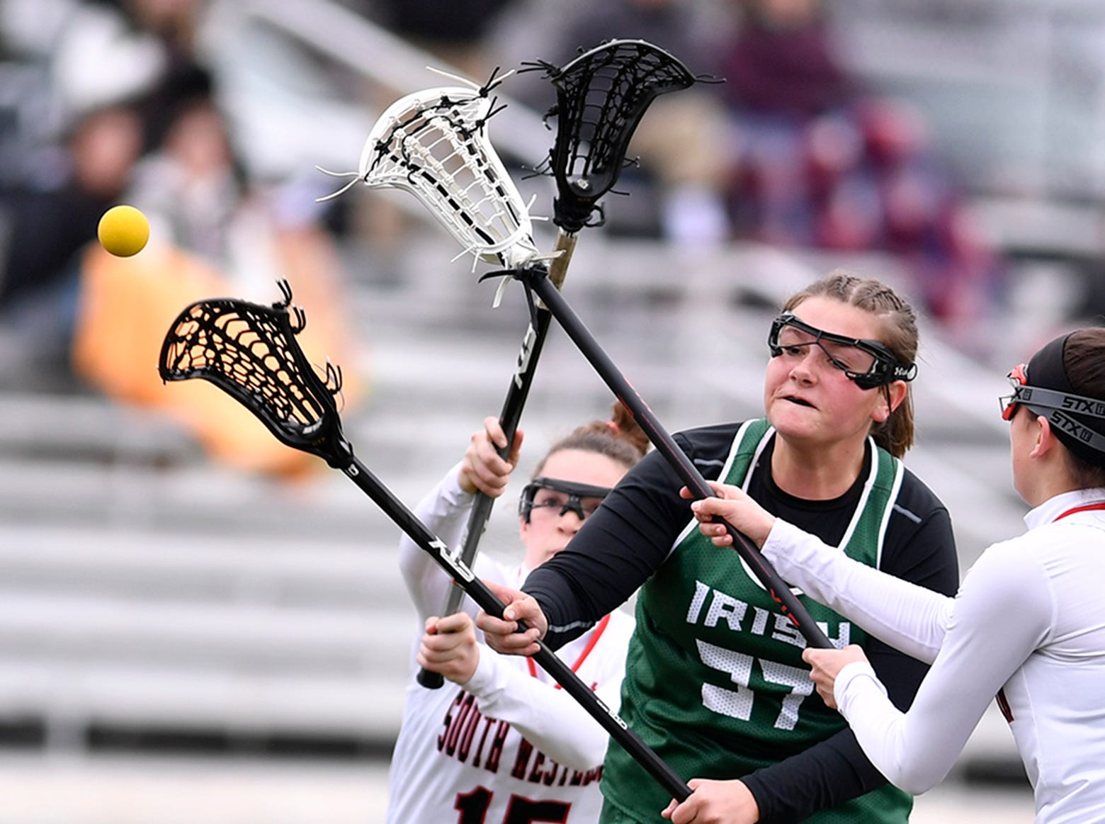York Catholic's Ella Linthicum shoots and scores while covered by Jordan Gertz, left, and Ella Baker of South Western, Tuesday, April 2, 2019.John A. Pavoncello photo