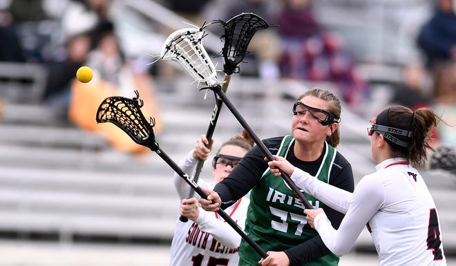 York Catholic's Ella Linthicum shoots and scores while covered by Jordan Gertz, left, and Ella Baker of South Western, in April of 2019. Linthicum is one of the top returning players for the Irish. John A. Pavoncello photo