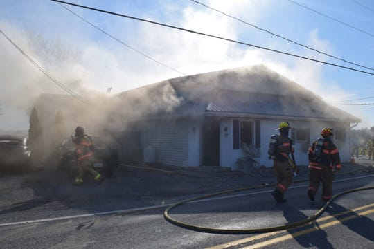 Fire crews responded to an apartment fire near American Auto Body at 304 W. Main St. Monday, April 1. Photo courtesy of South County Fire Photos.