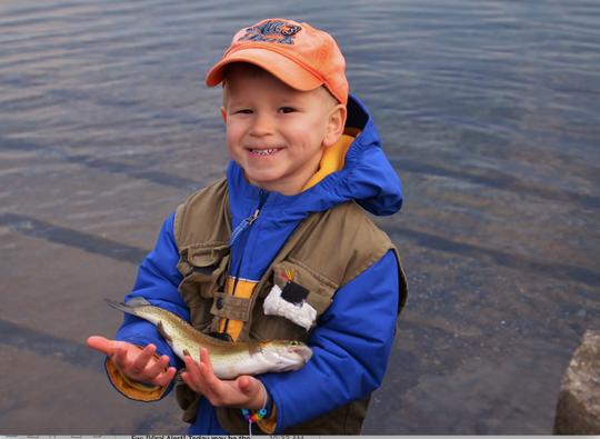 Liam with a nice Rainbow trout he caught, and released from Children's Lake.