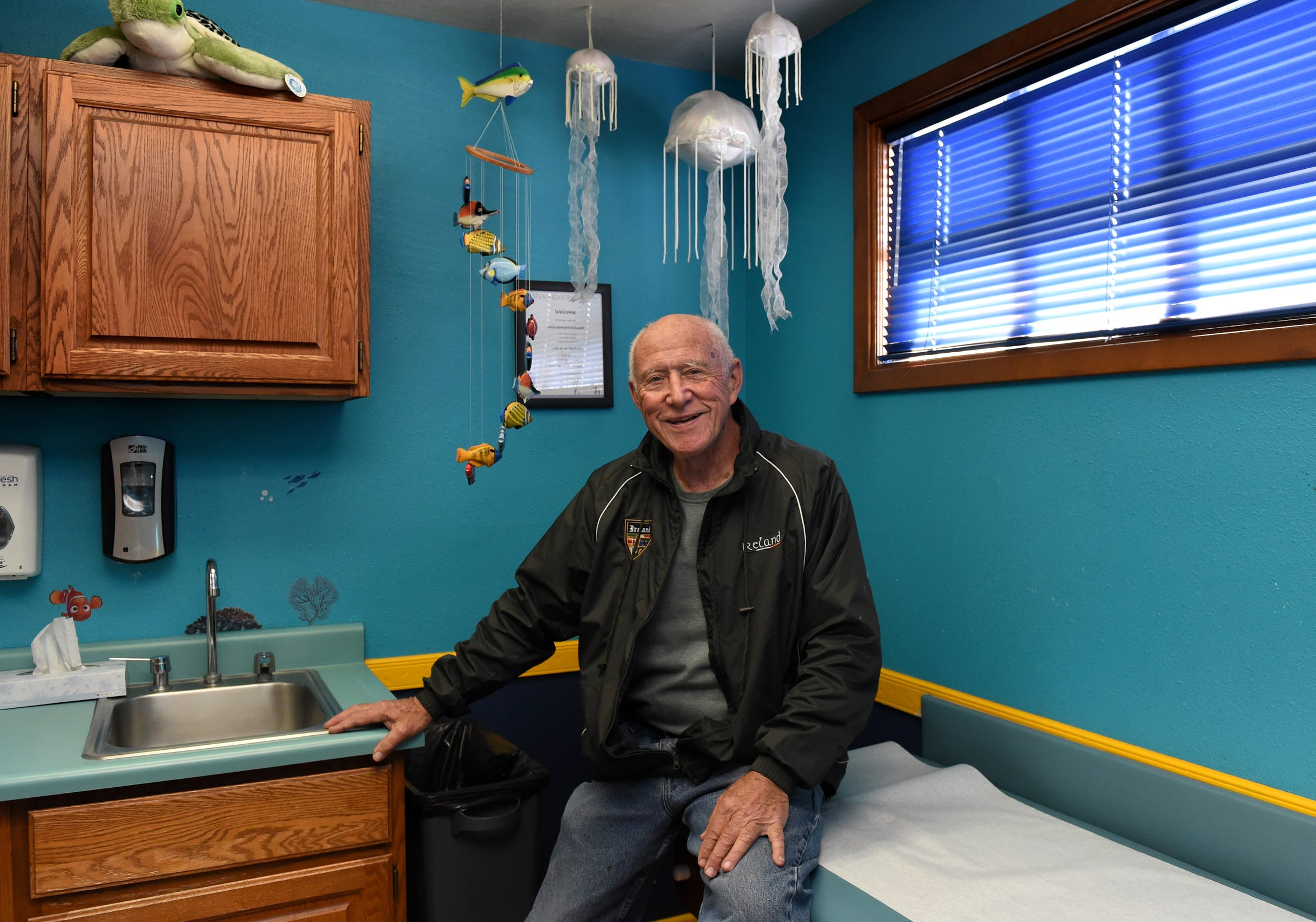 Dr. Patrick Colletti sits in one of the exam rooms.  Dr. Colletti is retiring after 50 years of pediatric practice in Reno.