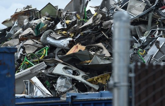 Lime Bikes are seen sticking out of a pile of scrap metal at a downtown Reno scrapyard on April 2, 2019.