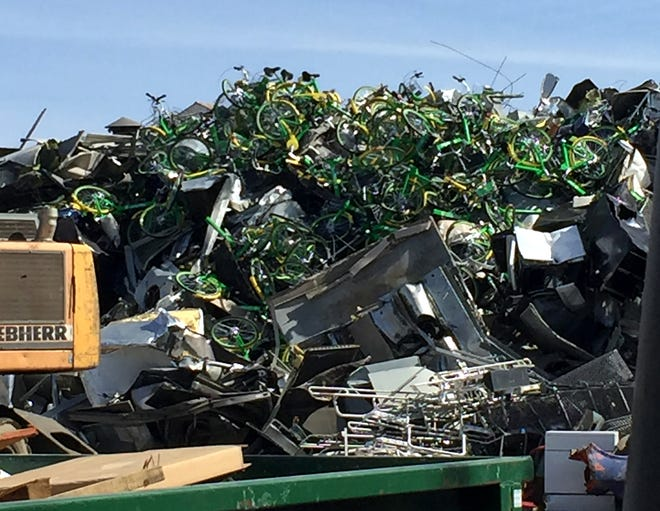 Lime Bikes are seen on top of a pile of scrap metal at a downtown Reno scrapyard on March 31, 2019. Photo courtesy of Joey Sandoval.
