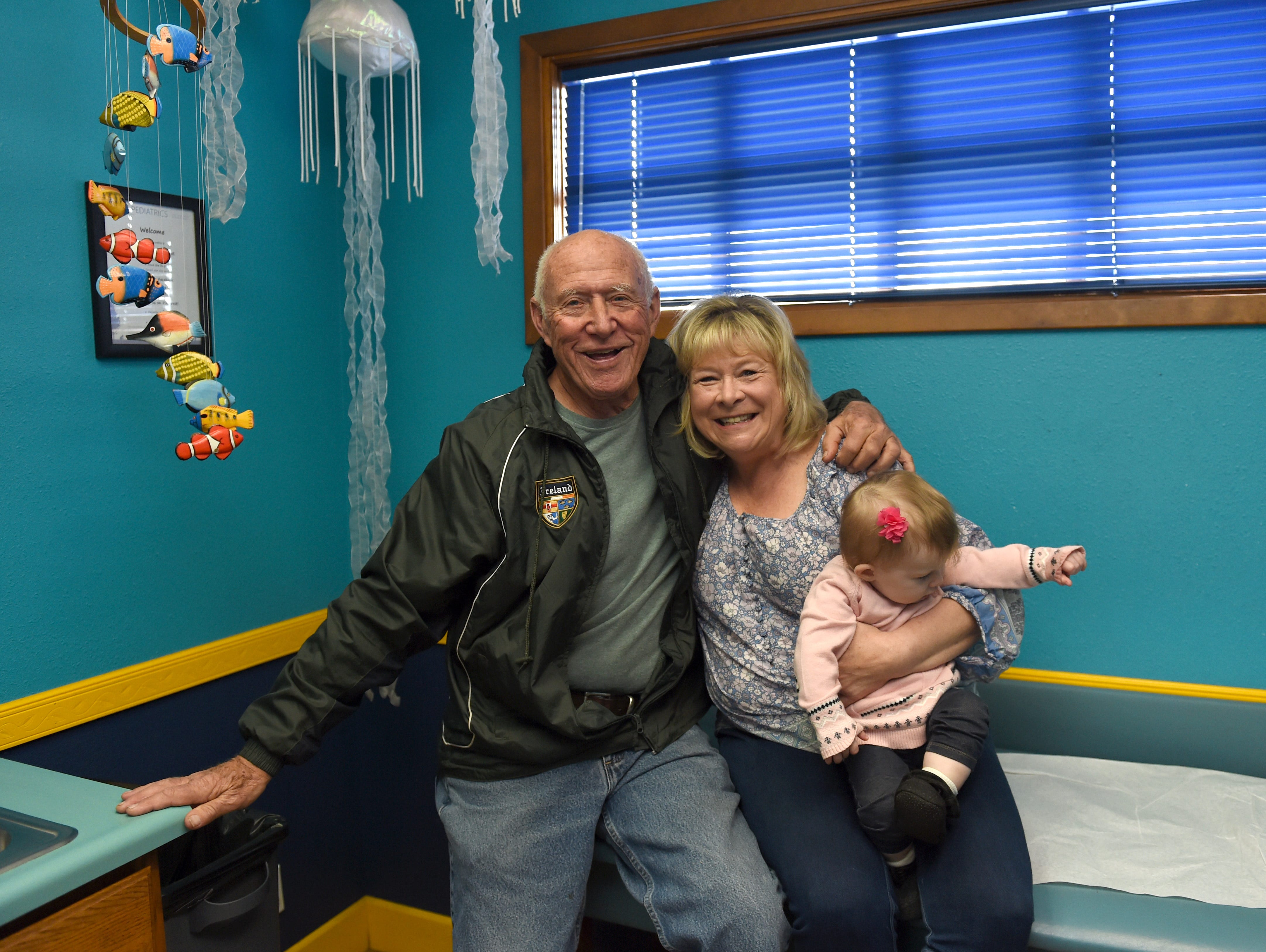 Dr. Patrick Colletti poses for a photo with his long-time nurse Jane Prescott, who is holding her granddaughter Blair Gutierrez, 10 months, at the Aspen Pediatrics. Dr. Colletti will be retiring after 50 years of pediatric practice in Reno.