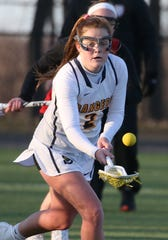 Spencerport's Erin Coykendall scoops up a loose ball and heads upfield in a game against Penfield on April 2.