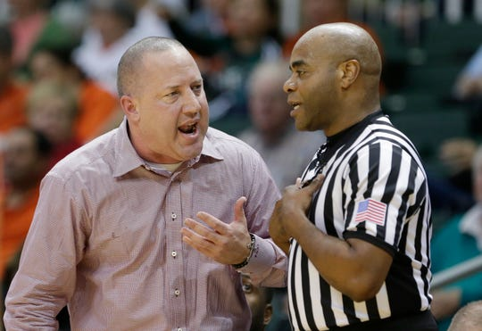 Virginia Tech coach Buzz Williams argues with official Jeffrey Anderson after receiving a technical foul during the second half of Virginia Tech's NCAA college basketball game against Miami, Wednesday, Feb. 18, 2015, in Coral Gables, Fla. Anderson, a Rochester resident, will work his third straight Final Four this weekend.