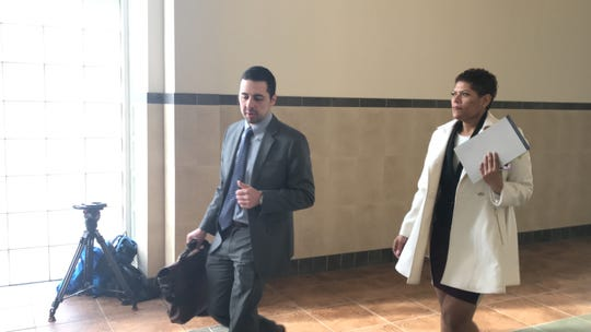 Leticia Astacio, left, enters an Onondaga County courtroom Tuesday morning accompanied by her attorney, Mark Foti.