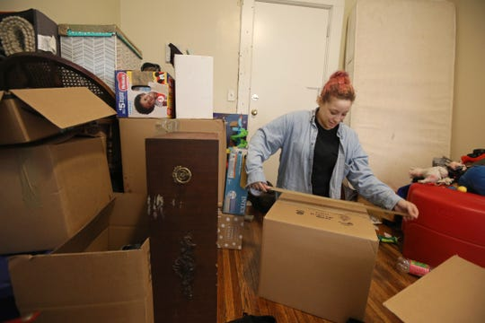 Barbara Rivera, a tenant at 447 Thurston Road, packs up all her belongings as she prepares to move from the apartment building Monday, April 1, 2019 at Rochester.