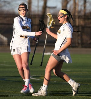 Spencerport's Olivia Wall, right, celebrates her first half goal with teammate Paige Pohleven. Spencerport defeated Penfield 7-6 on April 1, 2019.