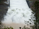 California officials opened the flood-control spillway at the nation's tallest dam for the first time since it was rebuilt after it crumbled during heavy rains two years ago.