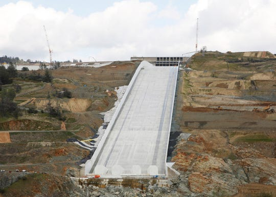 This Feb. 20, 2019, photo shows the Oroville Dam spillway in Oroville, Calif. California officials say the flood-control spillway is being used for the first time since it was rebuilt after it crumbled during heavy rains two years earlier, forcing nearly 2000,000 people to evacuate.