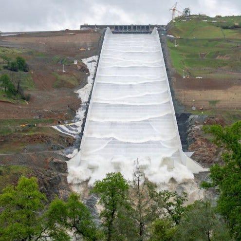 UPDATE: Rebuilt Oroville Dam spillway begins releasing water