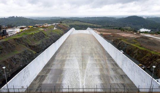 Water flows down the Oroville Dam spillway Tuesday, April 2, 2019. California officials opened the flood-control spillway at the nation's tallest dam for the first time since it was rebuilt after it crumbled during heavy rains two years ago.
