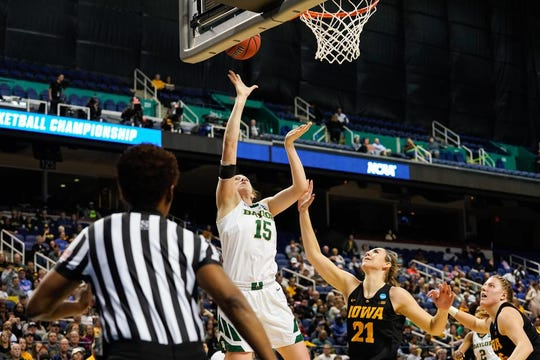 Apr 1, 2019; Greensboro, NC, USA; Baylor Lady Bears center Kalani Brown (21) shoots the ball past Iowa Hawkeyes forward Hannah Stewart (21) during the first half in the championship game of the Greensboro regional in the women's 2019 NCAA Tournament at the Greensboro Coliseum. Mandatory Credit: Jim Dedmon-USA TODAY Sports