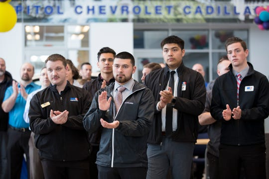 Employees clap during a check presentation from Capitol Auto to United Way of the Mid-Willamette Valley, of $200,000 raised by employees, in the Chevrolet lobby of Capitol Auto Group in Salem on April, 2, 2019.