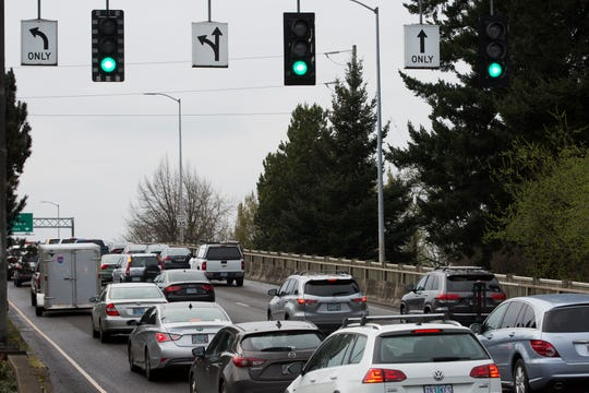 Traffic builds up on the Marion Street Bridge in Salem on April, 1, 2019.