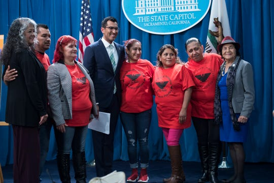Supporters of Rivas's Farmworker Housing Act, such as Dolores Huerta and United Farm Workers staff gather with him to pose for a photo onstage. April 2, 2019