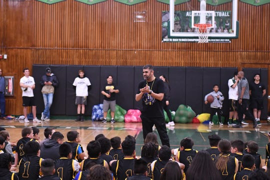 GBA co-founder Jose Gil leads an academy night Monday at Alisal High School. The night featured three hours of training, lessons and raffle winners who won tickets to Disneyland.