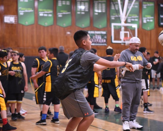 At the GBA Academy Nights, kids form groups of 12-15 and rotate through different areas of the gym to practice different skills like passing.