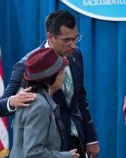 Assembleymember Robert Rivas speaks with organizer Dolores Huerta.