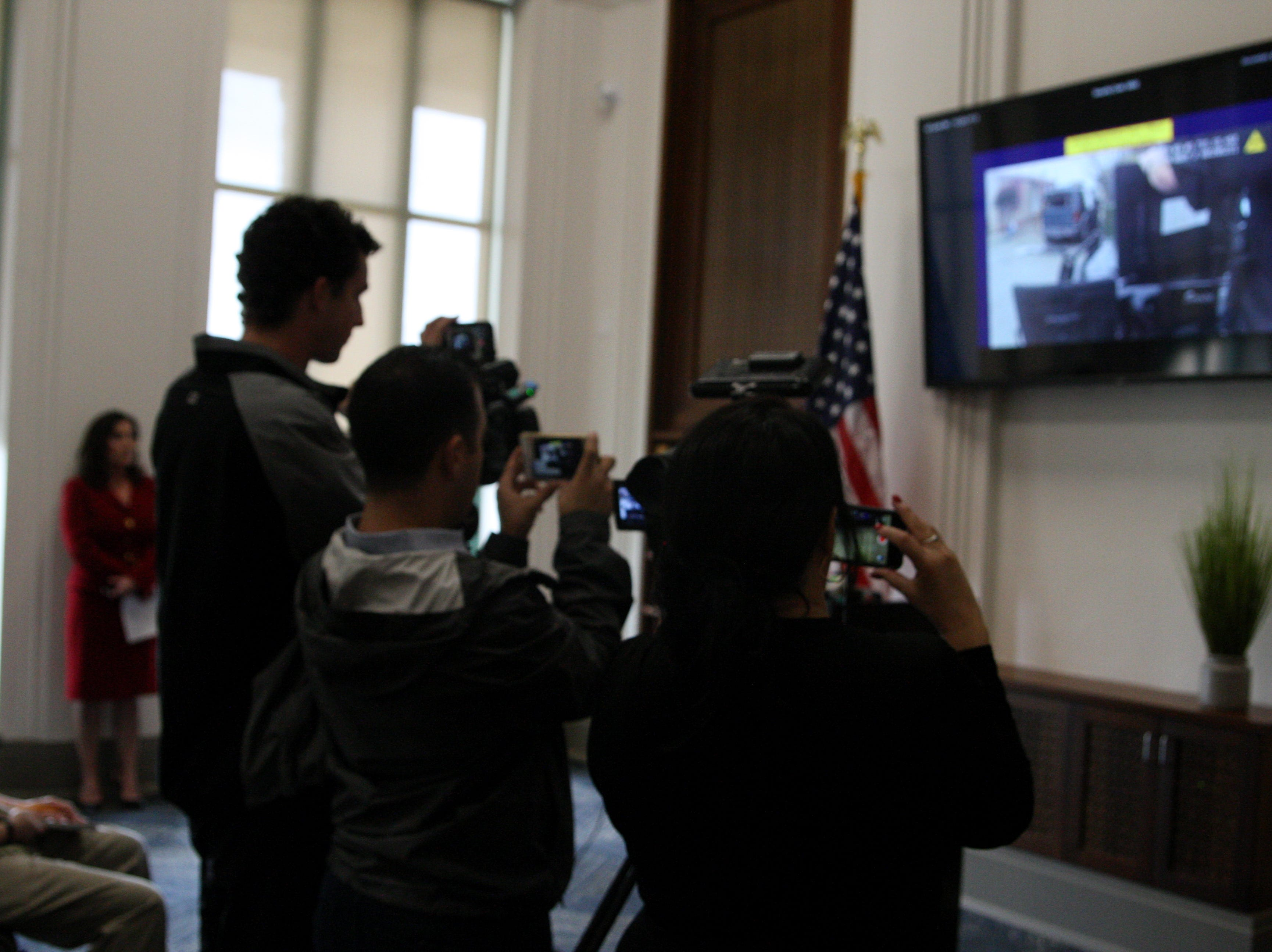 Reporters film the body camera footage of the shooting death of Brenda Mendoza, aka Brenda Rodriguez. April 2, 2019.
