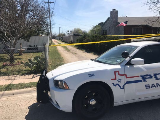 San Angelo police conduct a death investigation in an alleyway on Bowie Street Tuesday, April 2, 2019.