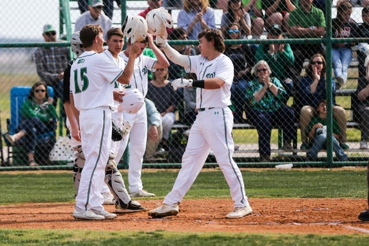 Wall players celebrate a home run against Brady Tuesday, April 2, 2019, at Wall.