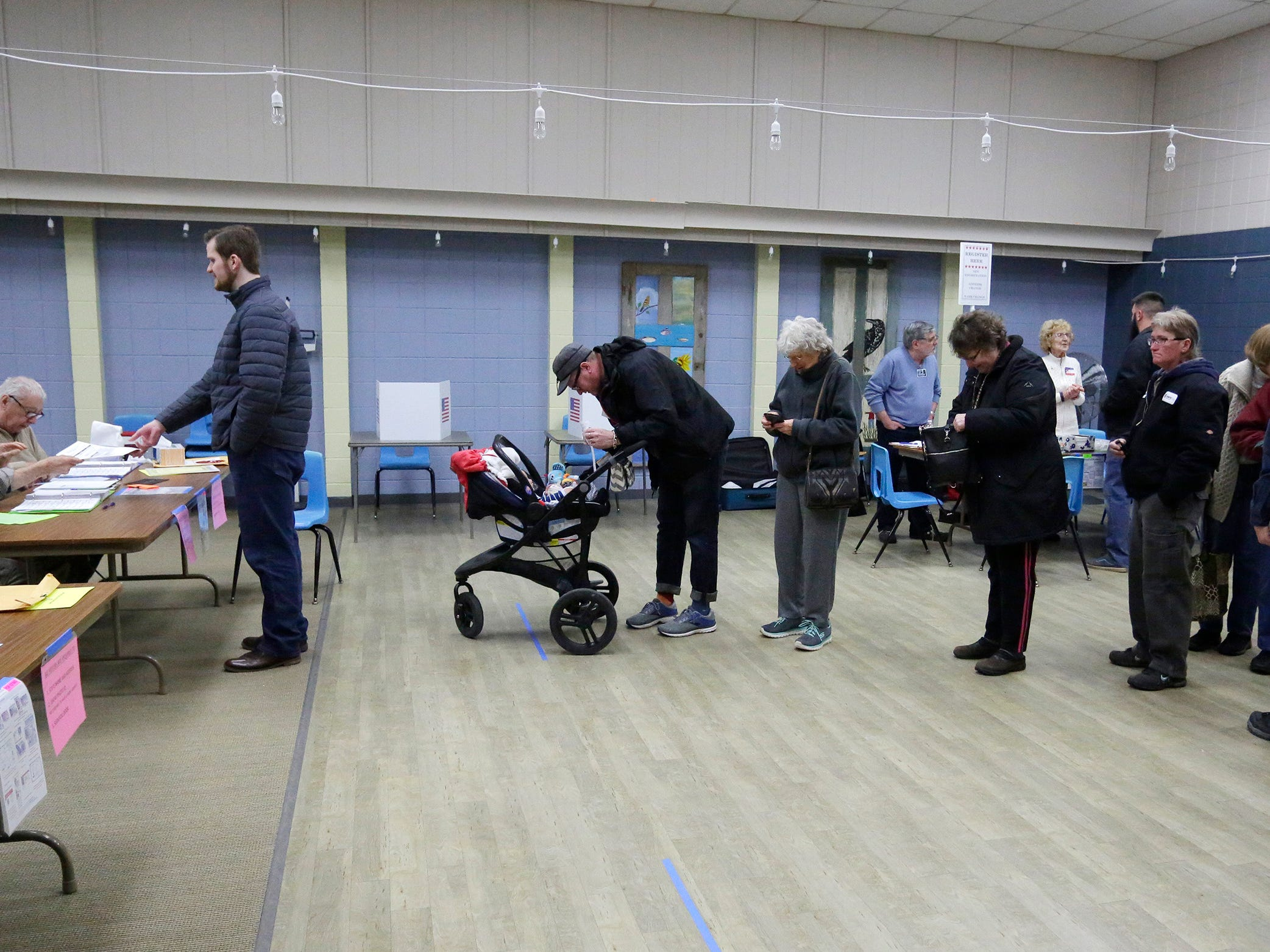 A line to vote at the Senior Activity Center, Tuesday, April 2, 2019, in Sheboygan, Wis.
