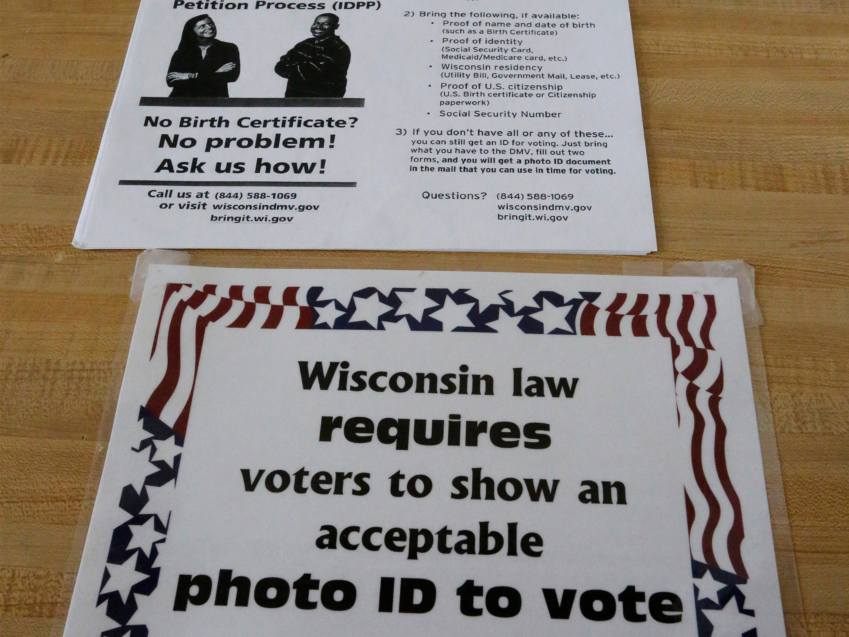 Voting instructions on display at the Good Shepherd Lutheran polls, Tuesday, April 2, 2019, in Sheboygan, Wis.