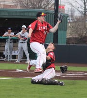 Brandon Valley pitcher Brad Skorczewski makes a play on a foul bunt as catcher Dylan Dielke looks on against Topeka (KS) Seaman.