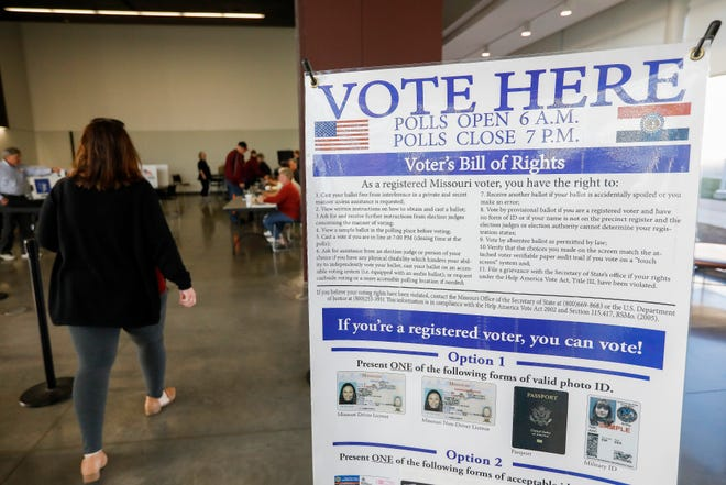 People walk in to vote at the Davis-Harrington Welcome Center at Missouri State University on Tuesday, April 2, 2019.