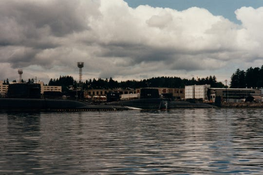 This is a 1995 photo of the USS Lapon, a submarine, that was taken in Bremerton, Washington shortly before the vessel  was scrapped.  The Lapon is on the right. The sail was given to the Ozark Runners, a nonprofit formed by area servicemen who have served on submarines.  The sail  is on display at American Legion Post 639 in Springfield.