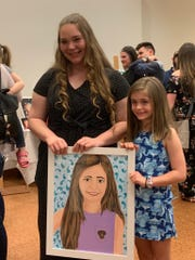 Shenandoah Valley Governor's School student Naomi Ritchie painted 17 portraits of local cancer patients for her senior year project. The paintings were unveiled at a reception March 29, 2019.