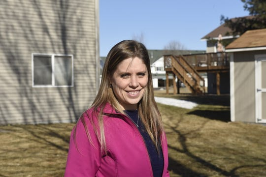 Lauren Line, a neonatal nurse practitioner at St. Cloud Hospital, poses for a photo outside her home Friday, March 29th.