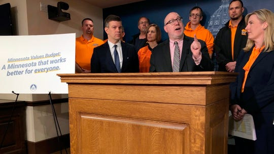 Minnesota House Transportation Committee Chairman Frank Hornstein, center, flanked by House Majority Leader Ryan Winkler, left, and House Speaker Melissa Hortman, discusses a House Democratic transportation budget proposal on Tuesday, April 2, 2019 in St. Paul, Minn. (AP Photo/Steve Karnowski)