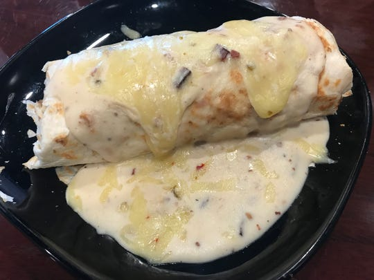 """Pork Belly's """"Big Hoss"""" burrito can be ordered with the choice of carne asada, pulled pork, tri-tip, bacon or sausage."""