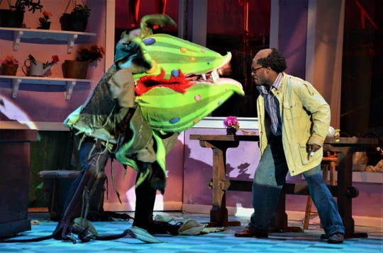 "Seymour (Sherrod Taylor) confronts Audrey II (Kyle Hunter), his plant that's grown out of control in FAMU Essential Theatre's ""Little Shop of Horrors."""