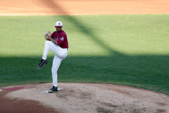 Florida State University's J.C. Flowers (8) throws a pitch during a game between FSU and Jacksonville University at Dick Howser Stadium Tuesday, April 2, 2019.