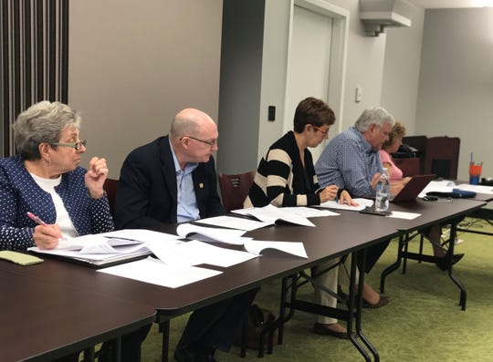 Citizens for Ethics Reform members (from left) Marilyn Wills, Ben Wilcox, Catherine Baer and Peter Butzin take part in an Independent Ethics Board workshop Tuesday, April 2, 2019.