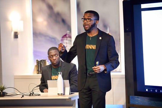 Florida A&M University student KIeishon Smith, left, watches as Emmanuel Dawson, right., makes pitch during entrepreneurship competition among 10 HBCUs last weekend in Detroit. The FAMU team took first place.