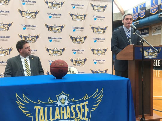 TCC's newly-hired men's basketball head coach Zach Settembre discusses his plans to guide the program during his opening press conference. Athletics director Rob Chaney (left) watches while he speaks with to the media.