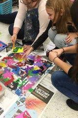 In collaborative groups, students discussed issues that were important to them then designed their artworks.