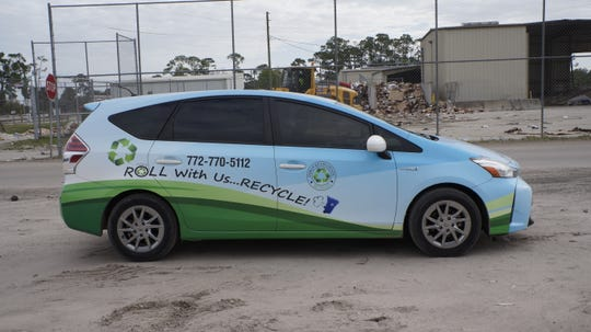 Even the cars at the landfill promote recycling.