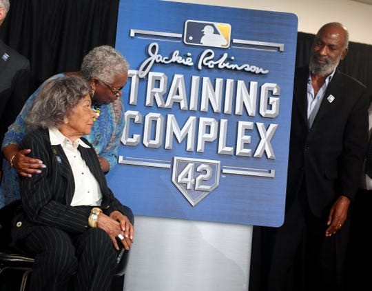 Rachel Robinson (seated), wife of Major League Baseball great Jackie Robinson, daughter Sharon Robinson and son David Robinson, gathered with MLB and local officials on Tuesday, April 2, 2019 for a news conference to announce Historic Dogertown's rebranding as the Jackie Robinson Training Complex. In December, MLB agreed to lease the former Dodgers spring training facility from Indian River County.
