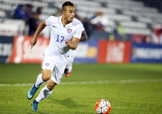 USA forward Jerome Kieswetter brings the ball up the field during a 2015 Olympic qualifying match against Panama