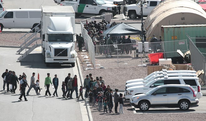 Migrants are moved through the Border Patrol facility at Hondo Pass and U.S. 54 recently. Tents were being constructed at the site.