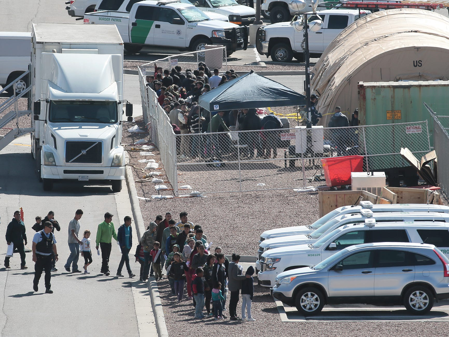 Migrants are moved through the Border Patrol Facility at Hondo Pass and US54 Wednesday. Tents are being constructed at the site.