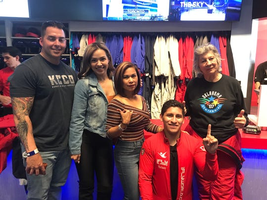 The first class of flyers with their instructor Brian Rodriguez at iFly Indoor Skydiving, which opened Tuesday.