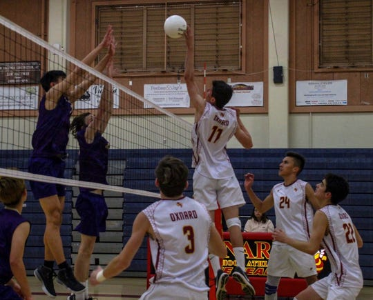 Edgar Medina rises well above the net during a match earlier this season. Medina is part of a deep and talented Oxnard boys volleyball team.